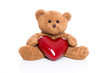 Teddybär isoliert mit Herz in Rot zu Valentin
