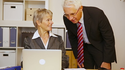 Business man helping woman in office