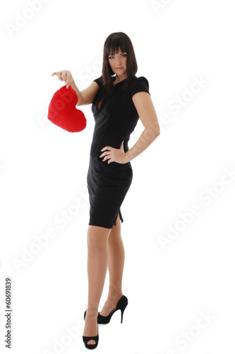 Elegant woman in dress and heels holding heart