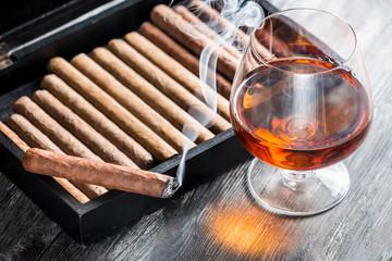Aroma of cognac and smoking a cigar