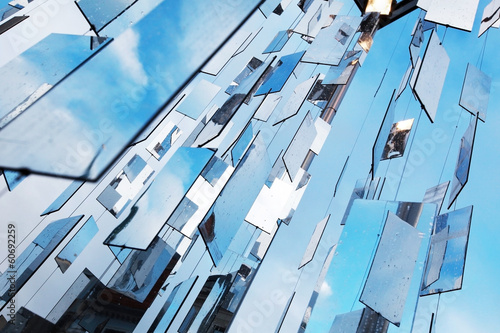 Abstract blue background with mirrors above the sky