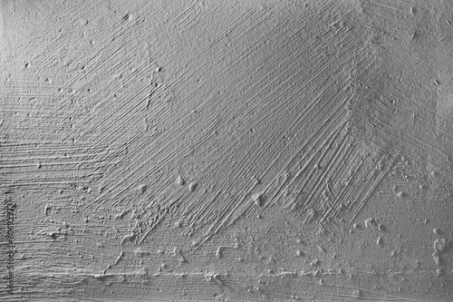 Gray concrete wall with plaster relief. Background texture