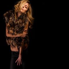 blonde in fur vest