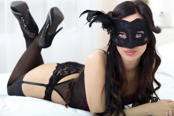 top view picture of sexy masked girl in black lingerie lying on