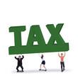 Business team lifts a tax sign