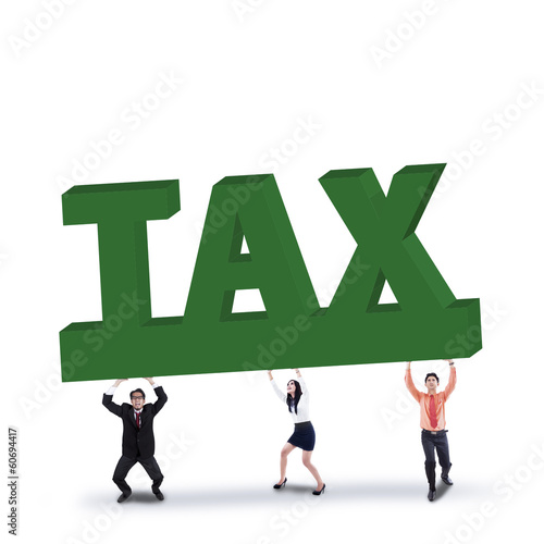 Business team lifts a tax sign