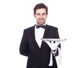 Handsome waiter holding an empty silver tray, isolated on white