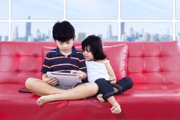 Children using tablet together