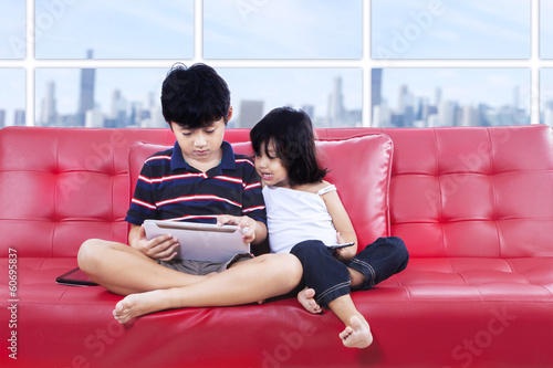 Children using tablet together