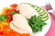 Boiled chicken breast on plate with vegetables close up