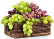 Ripe green and purple grapes in basket isolated on white
