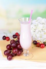 Milk shake on table on light blue background