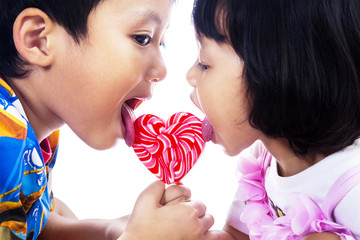 Two children with lollipop