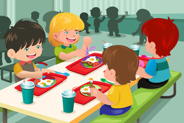 Elementary students eating  lunch in cafeteria