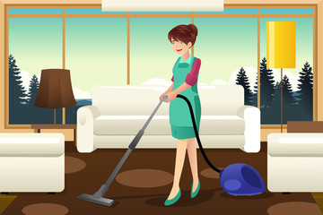 Professional maid vacuuming carpet