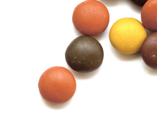 Close up of a pile of colorful chocolate coated candy