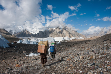 Porters carrying heavy loads in Karakoram range, Pakistan