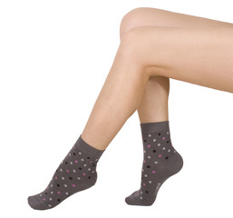 Female legs in socks. Isolated on white