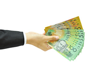 Hand holding money - Australian dollars