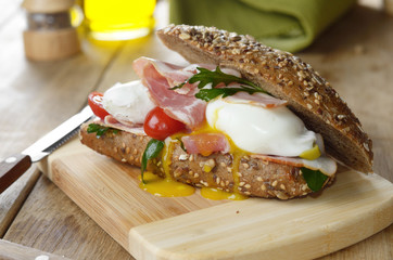 Bacon and poached eggs sandwich