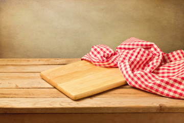 Cutting board and tablecloth on wooden table