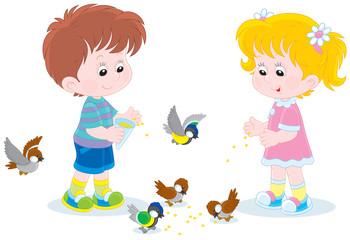 Children feed small birds
