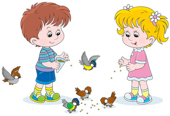 children feed a small flock of sparrows and titmice