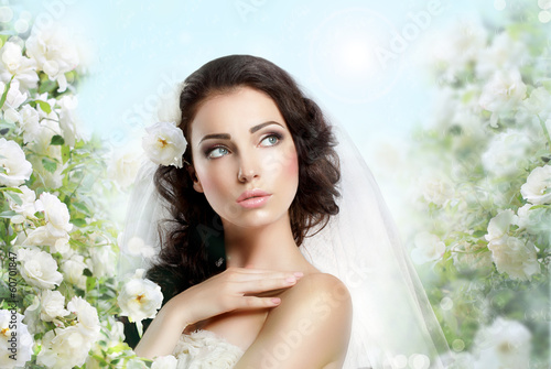 Exquisite Woman with Flowers over Vernal Floral Background