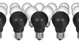 Row of black light bulbs in front of white ones poster