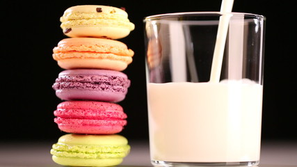 multicolored macaroon and pouring milk