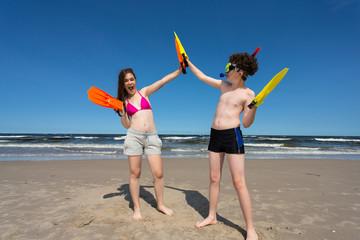 Teenage girl and boy on beach