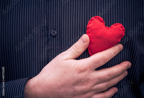 closeup red heart hand man