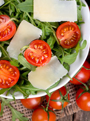 fresh salad from rucola, cherry tomatoes and parmesan cheese