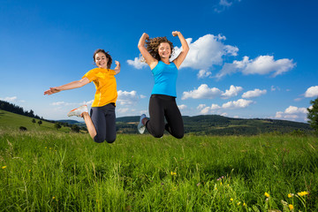 Young women jumping outdoor