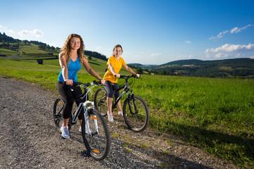 Healthy lifestyle - young women biking