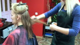Hairdresser scissors give haircut to female customer at parlor poster