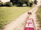 little girl walking along a country road