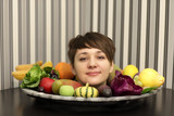 Girl and plate of fruits