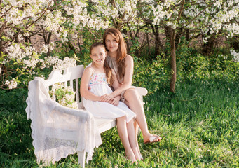 Happy mother with daughter in spring garden