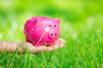 Piggybank in hand