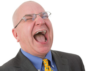 Middle-aged bald businessman laughing out loud