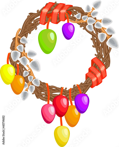 Easter wreath with willows, colored eggs and ribbons on a white