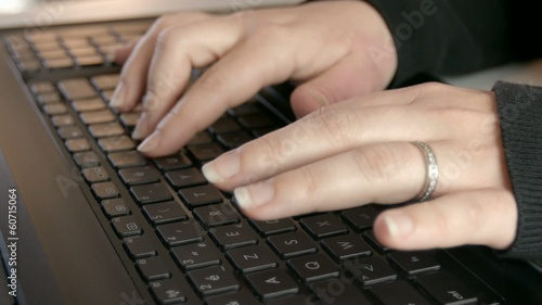 Woman hands typing on computer keyboard.
