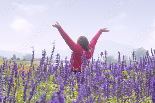 Woman Relaxing In Flower Fields