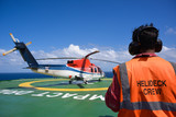 Helicopter with helicopter crew on oil rig helipad