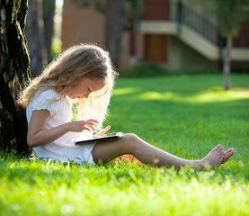 Child with tablet pc outdoors