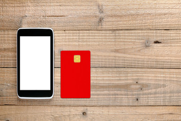 Smartphone and credit card on wooden background