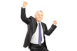 Ecstatic businessman with hands in the air