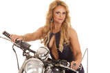 Mature woman open shirt on motorcycle