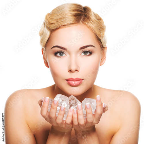 Beautiful young woman with ice in her hands